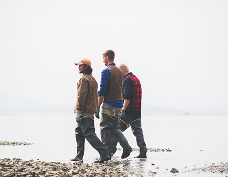 three-fishermen-walking-beach.jpg